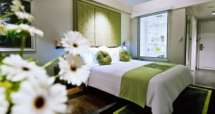 5-moevenpick-hotel-hanoi-female-business-traveller-room